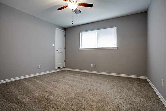 one of three bedroom with lots of closets