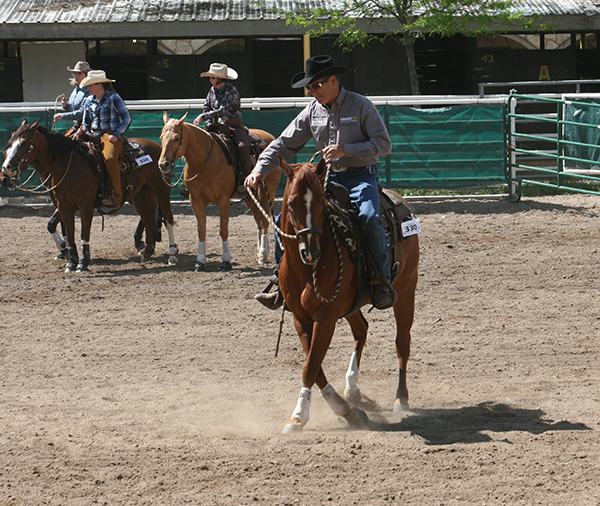 I'm pushing my horse's shoulders around to the right to   correct a dropped left shoulder