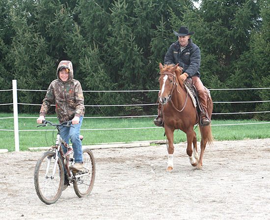 Following Bike – This colt is learning to follow his fears