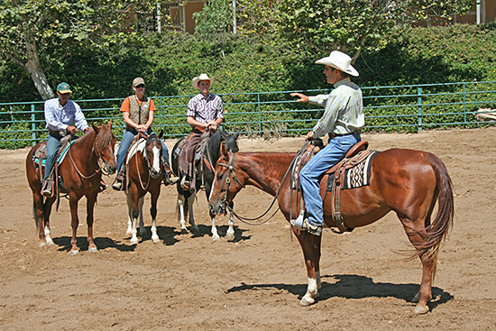 Three aspiring trainers listening to my horsemanship speech.